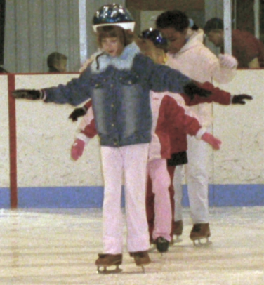 diana practices balancing on skates.